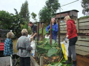 Filling a compost cage during blitz#8